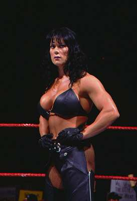 Chyna standing in the ring with her hands on her hips