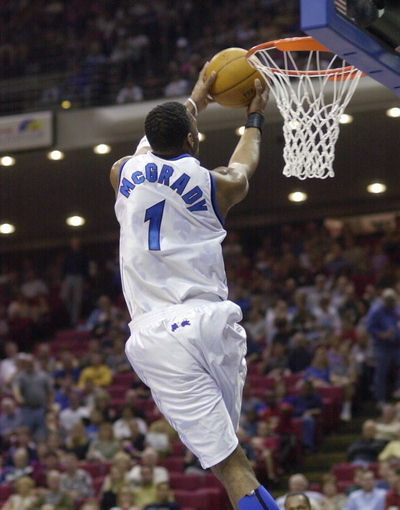 The Orlando Magic s Tracy McGrady is taking off to dunk during regular    Tracy Mcgrady Dunk