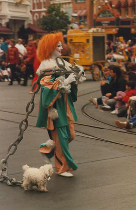Clown Walking Dog